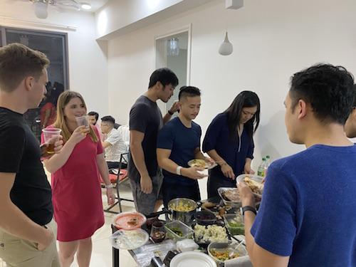 Friends preparing Thanksgiving dinner plates