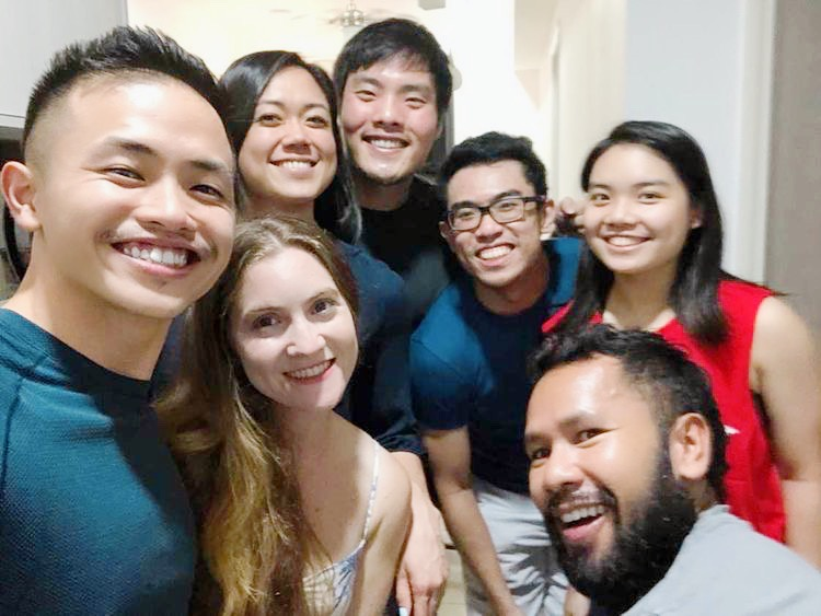 Seven friends smiling for a selfie