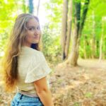 Girl walks in woods