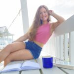 Girl in Crop Top on Porch